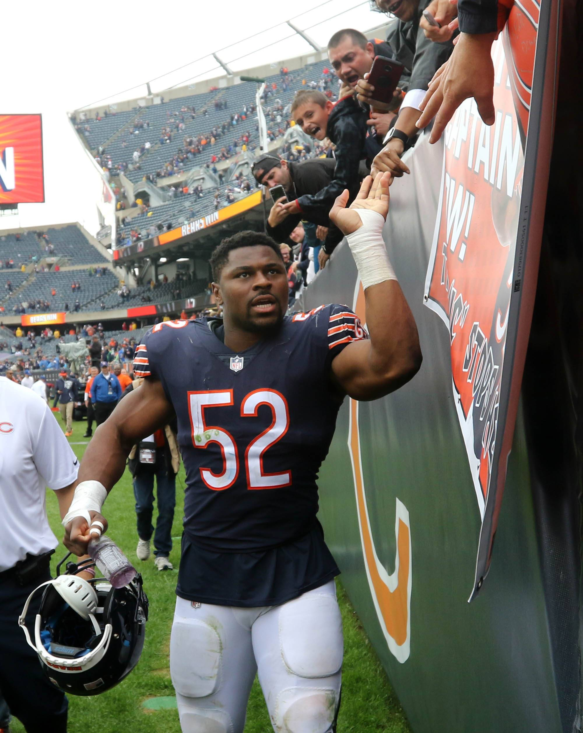 Chicago Bears linebacker Khalil Mack celebrates with fans after a win last year at Soldier Field. Mack is scheduled to play ball at Boomers Stadium in Schaumburg on June 15 for teammate Eddie Jackson's inaugural Offense vs Defense Charity Softball Game.