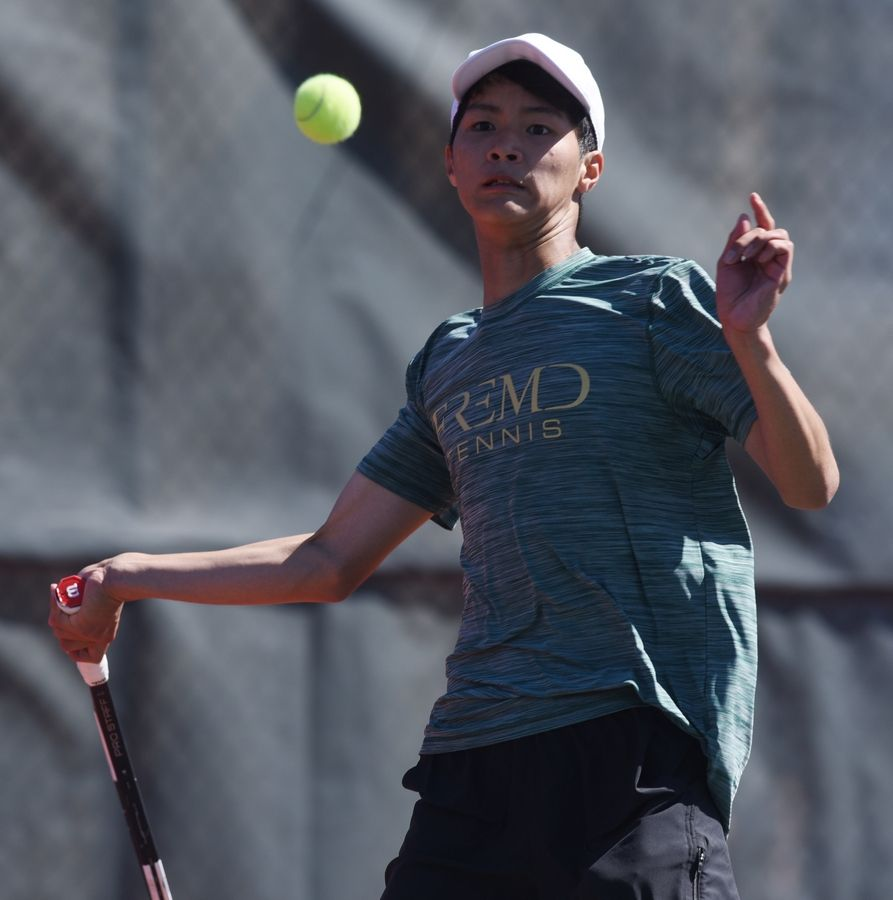 Fremd's Casey Hishinuma returns the ball in his match with O'Fallon's Niko Papachrisanthou during the boys state tennis tournament at Barrington Thursday.
