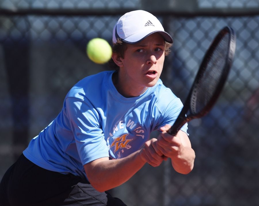 Maine West's Kamil Kozerski hustles to return the ball in his match with St. Charles North's Conor Bajuk during the boys state tennis tournament at Barrington Thursday.