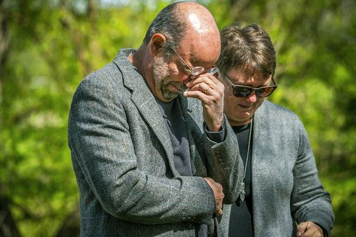 In this Saturday, May 11, 2019 photo, Jeff Purvis cries during a ceremony for Price Joyce, a slave once owned by his great-great-great-grandfather, Alexander Joyce II, at Sampson Cemetery, in southern Marion county, Ind.   (Mykal McEldowney/The Indianapolis Star via AP)