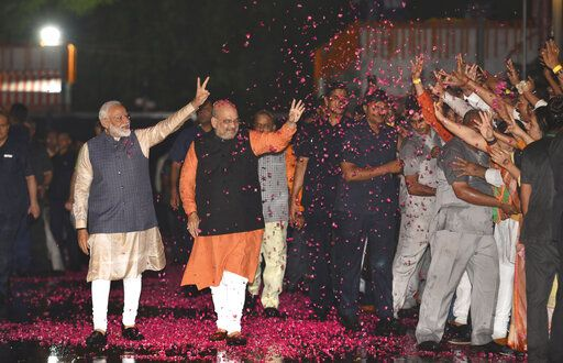 Indian Prime Minister Narendra Modi and Bharatiya Janata Party (BJP) President Amit Shah greet supporters on arrival at the party headquarters in New Delhi, India, Thursday, May 23, 2019. Modi's Hindu nationalist party claimed it won reelection with a commanding lead in Thursday's vote count, while the head of the main opposition party conceded a personal defeat that signaled the end of an era for modern India's main political dynasty.