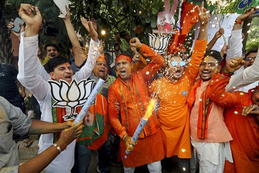 Bharatiya Janata Party (BJP) workers celebrate outside BJP headquarters in New Delhi India, Thursday, May 23, 2019. Indian Prime Minister Narendra Modi and his party have a commanding lead in early vote counting from the country's six-week general election.
