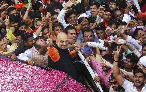 India's ruling Bharatiya Janata Party (BJP) President Amit Shah displays the victory sign as he arrives at the party office in new Delhi, India, Thursday, May 23, 2019. Indian Prime Minister Narendra Modi's party claimed it had won reelection with a commanding lead in Thursday's vote count, while the stock market soared in anticipation of another five-year term for the pro-business Hindu nationalist leader.