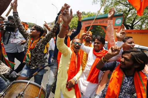 Bharatiya Janata Party (BJP) workers celebrate at BJP headquarters in, Lucknow, India, Thursday, May 23, 2019.  Indian Prime Minister Narendra Modi and his party were off to an early lead as vote counting began Thursday following the conclusion of the country's 6-week-long general election, sending the stock market soaring in anticipation of another five-year term for the Hindu nationalist leader.
