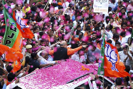 India's ruling Bharatiya Janata Party (BJP) President Amit Shah is showered with flower petals as he arrives at the party office in new Delhi, India, Thursday, May 23, 2019. Indian Prime Minister Narendra Modi's party claimed it had won reelection with a commanding lead in Thursday's vote count, while the stock market soared in anticipation of another five-year term for the pro-business Hindu nationalist leader.