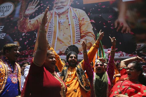 Bharatiya Janata Party (BJP) workers celebrate outside BJP headquarters in Mumbai, India, Thursday, May 23, 2019. Indian Prime Minister Narendra Modi and his party were off to an early lead as vote counting began Thursday following the conclusion of the country's 6-week-long general election, sending the stock market soaring in anticipation of another five-year term for the Hindu nationalist leader.