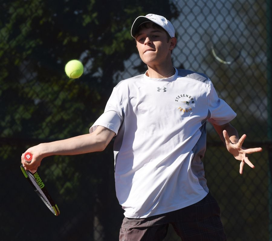 Stevenson's Eric Perkowski returns the ball during his match with Hinsdale South's Jacob John at the boys state tennis tournament at Barrington Thursday.