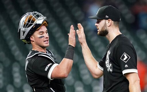 Chicago White Sox catcher James McCann, left, celebrates with starting pitcher Lucas Giolito after the team's baseball game against the Houston Astros Thursday, May 23, 2019, in Houston. Giolito threw a four-hitter as the White Sox won 4-0.