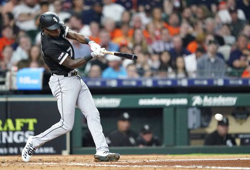 Chicago White Sox's Tim Anderson hits an RBI single against the Houston Astros during the third inning of a baseball game Thursday, May 23, 2019, in Houston.