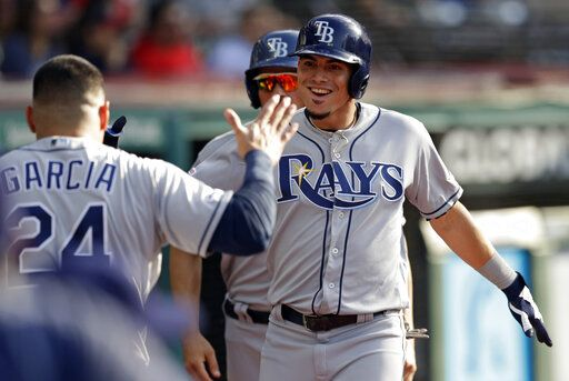 Tampa Bay Rays' Willy Adames, right, is congratulated by Avisail Garcia after Adames hit a solo home run off Cleveland Indians starting pitcher Adam Plutko during the second inning of a baseball game Thursday, May 23, 2019, in Cleveland.