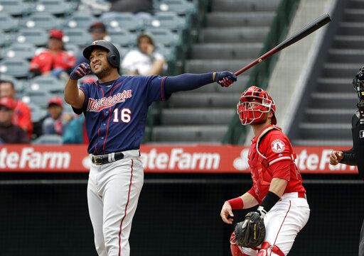 Minnesota Twins' Jonathan Schoop follows the path of his three-run home run against the Los Angeles Angels during the second inning of a baseball game Thursday, May 23, 2019, in Anaheim, Calif.
