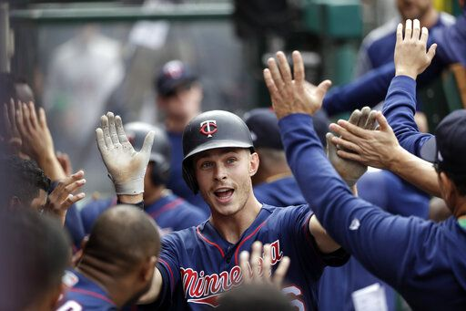 Minnesota Twins' Max Kepler, center, celebrates his two-run home run with teammates in the dugout during the seventh inning of the team's baseball game against the Los Angeles Angels on Thursday, May 23, 2019, in Anaheim, Calif.