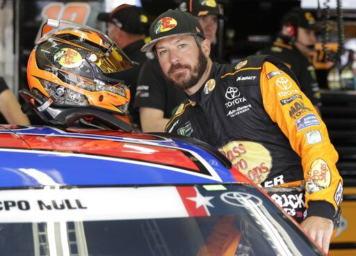 Martin Truex Jr. climbs into his car before practice for Sunday's NASCAR Coca-Cola 600 Cup series auto race at Charlotte Motor Speedway in Concord, N.C., Thursday, May 23, 2019.