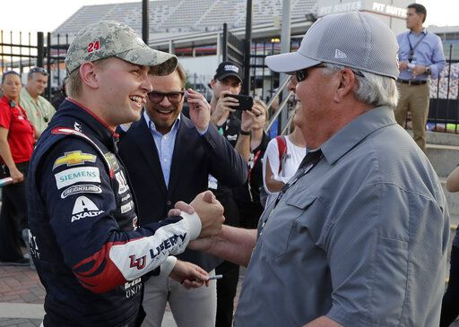 William Byron, left, is congratulated by team owner Rick Hendrick after winning the pole position during qualifying for Sunday's NASCAR Cup Series auto race at Charlotte Motor Speedway in Concord, N.C., Thursday, May 23, 2019.
