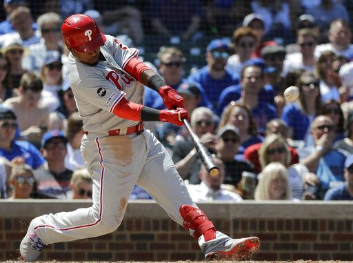 Philadelphia Phillies' Jean Segura hits a two-run home run against the Chicago Cubs during the fourth inning of a baseball game Thursday, May 23, 2019, in Chicago.