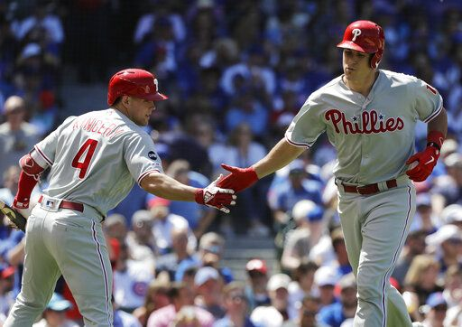Philadelphia Phillies' J.T. Realmuto, right, celebrates with Scott Kingery after hitting a solo home run against the Chicago Cubs during the third inning of a baseball game Thursday, May 23, 2019, in Chicago.