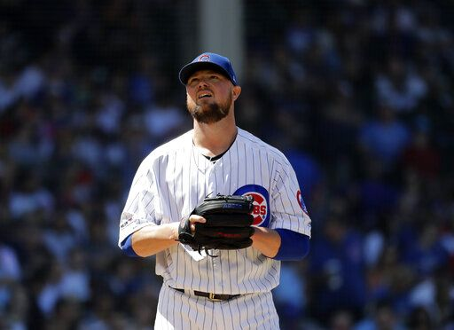 Chicago Cubs starting pitcher Jon Lester reacts as he looks up during the fourth inning of a baseball game against the Philadelphia Phillies, Thursday, May 23, 2019, in Chicago.