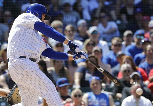 Chicago Cubs' Anthony Rizzo hits a two-run single during the fourth inning of a baseball game against the Philadelphia Phillies, Thursday, May 23, 2019, in Chicago.