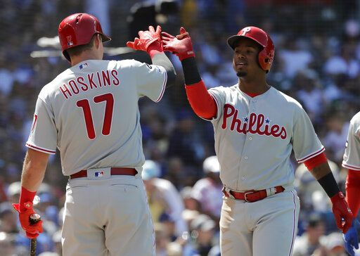 Philadelphia Phillies' Jean Segura, right, celebrates with Rhys Hoskins after hitting a two-run home run against the Chicago Cubs during the fourth inning of a baseball game Thursday, May 23, 2019, in Chicago.