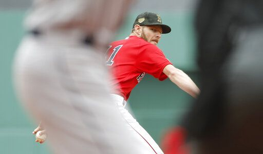 Boston Red Sox starting pitcher Chris Sale delivers against the Houston Astros during the first inning of a baseball game Sunday, May 19, 2019, at Fenway Park in Boston.