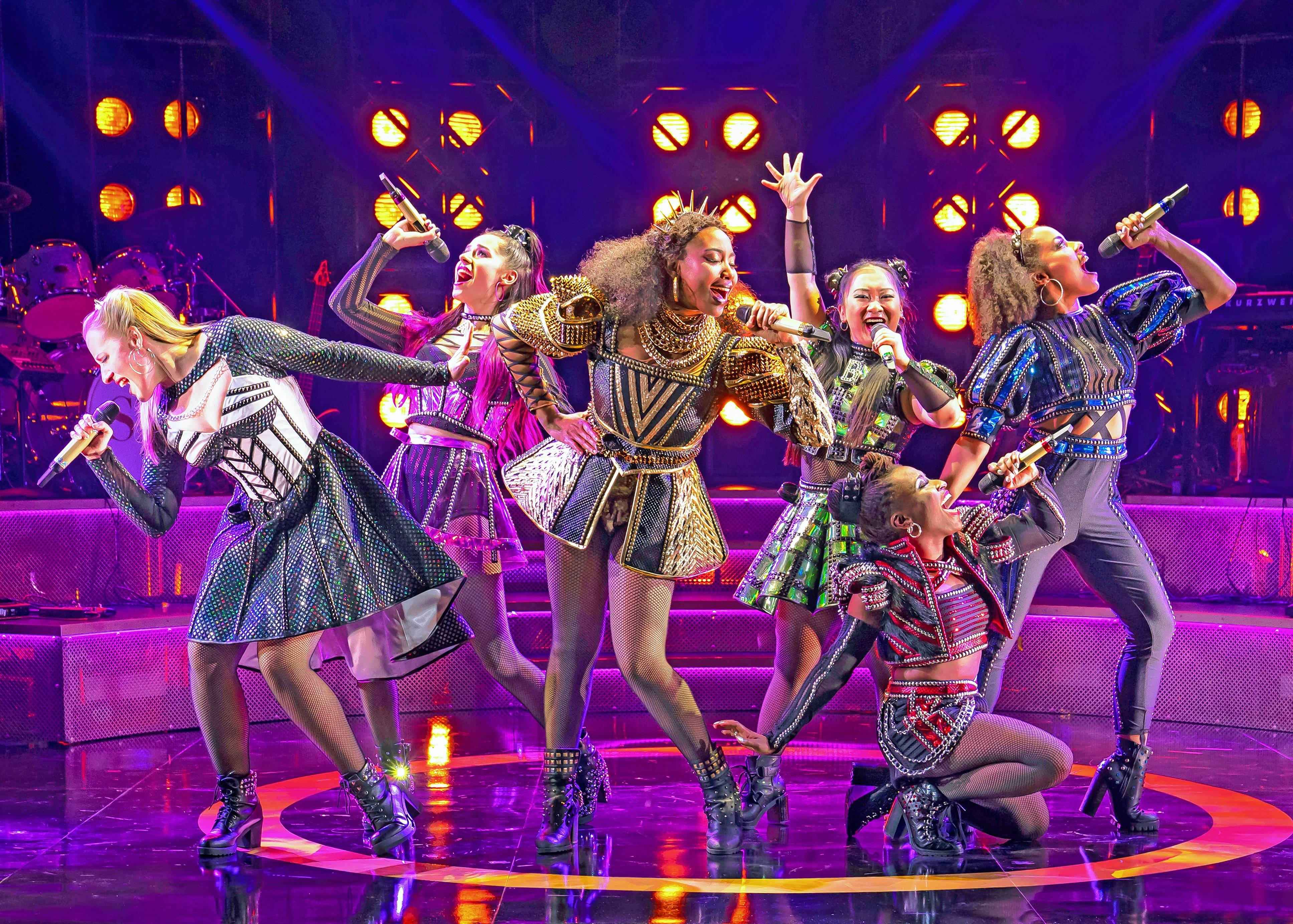 "Jane Seymour (Abby Mueller), left, Katherine Howard (Samantha Pauly), Catherine of Aragon (Adrianna Hicks), Anne Boleyn (Andrea Macasaet), Anna of Cleves (Brittney Mack) and Catherine Parr (Anna Uzele) rock out in ""SIX"" at Chicago Shakespeare Theater."
