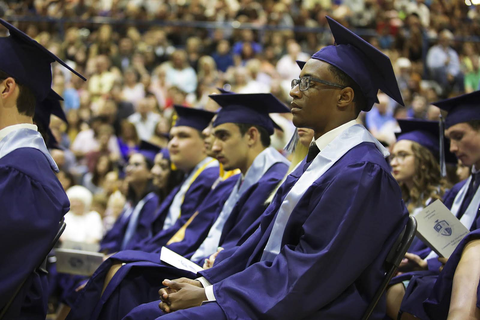 Graduates listen to speeches during the Downers Grove South Commencement Ceremony in Downers Grove May 24.