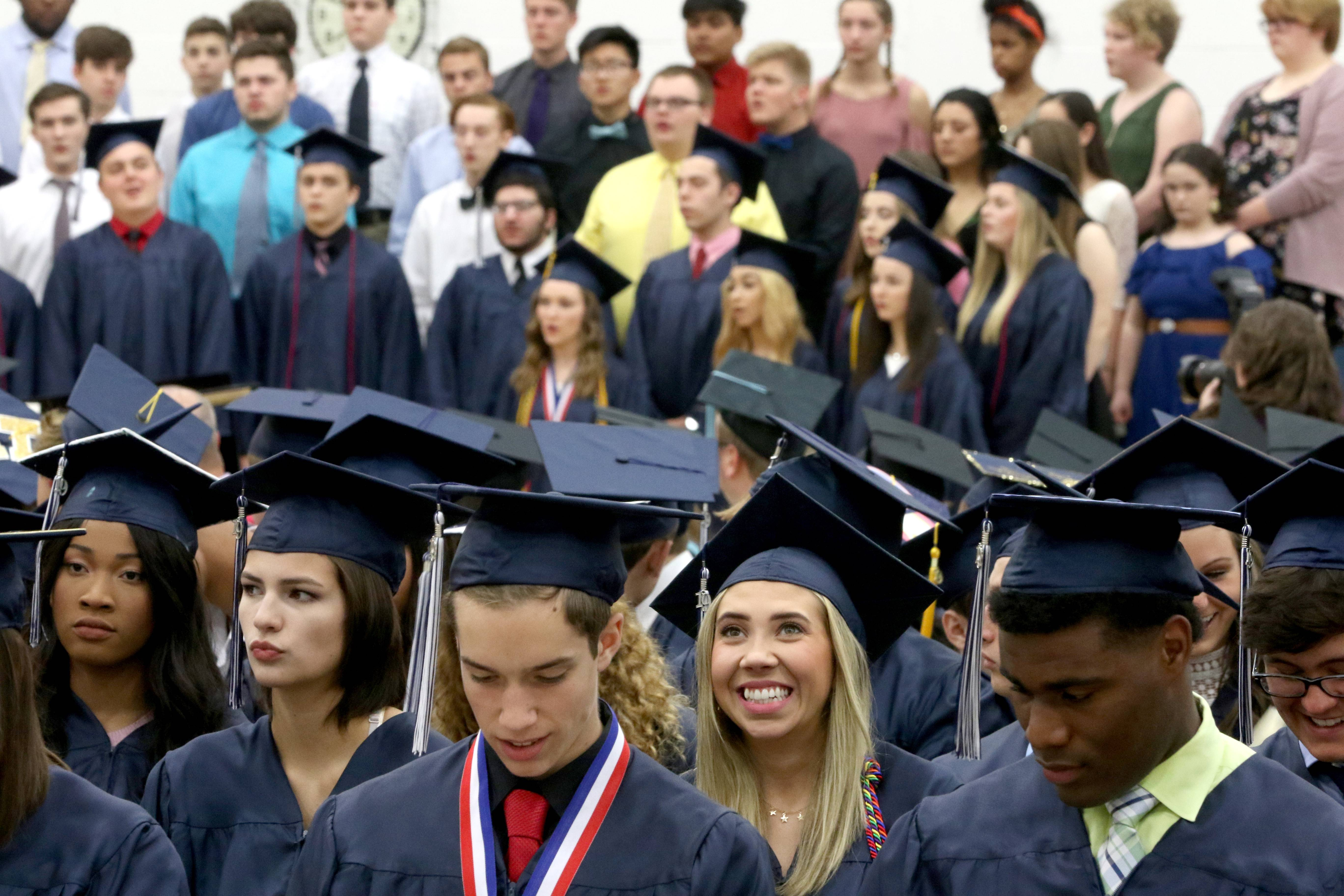 Members of the Class of 2019 listen to the choir perform during Lisle High School graduation on Friday, May 24, 2019 at the school.