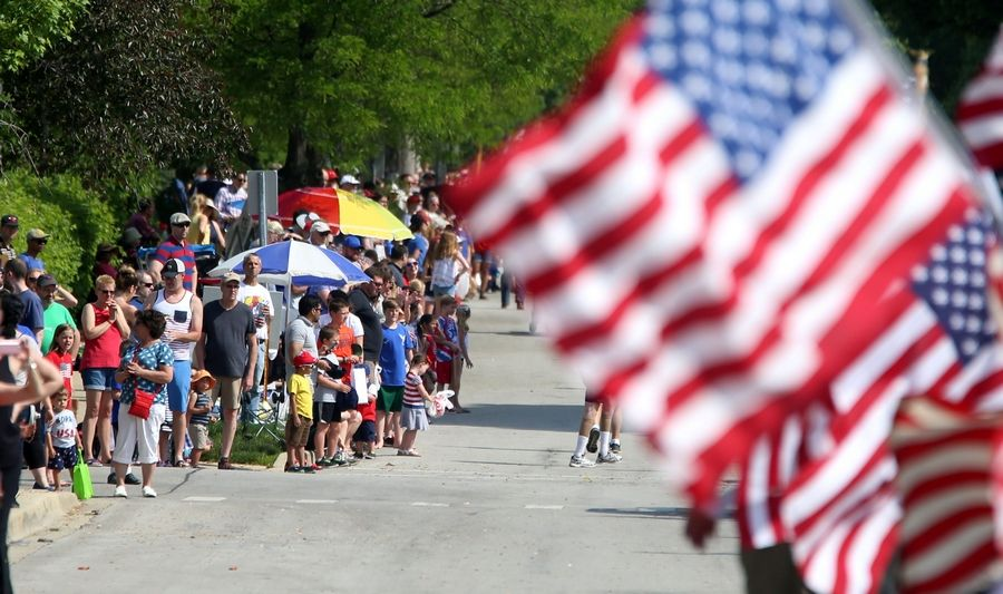 Crowds gather along Dunton Avenue during the Memorial Day parade in Arlington Heights in 2018. Thousands of marchers and spectators are expected this year for the parade's centennial.