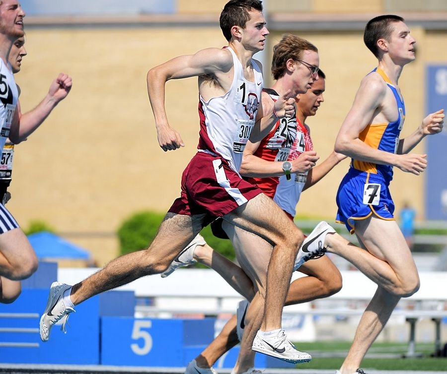 Antioch's Charlie Smith makes his final push for first place in the Class 3A 1,600-meter run at the IHSA boys state track preliminary events in Charleston Friday.