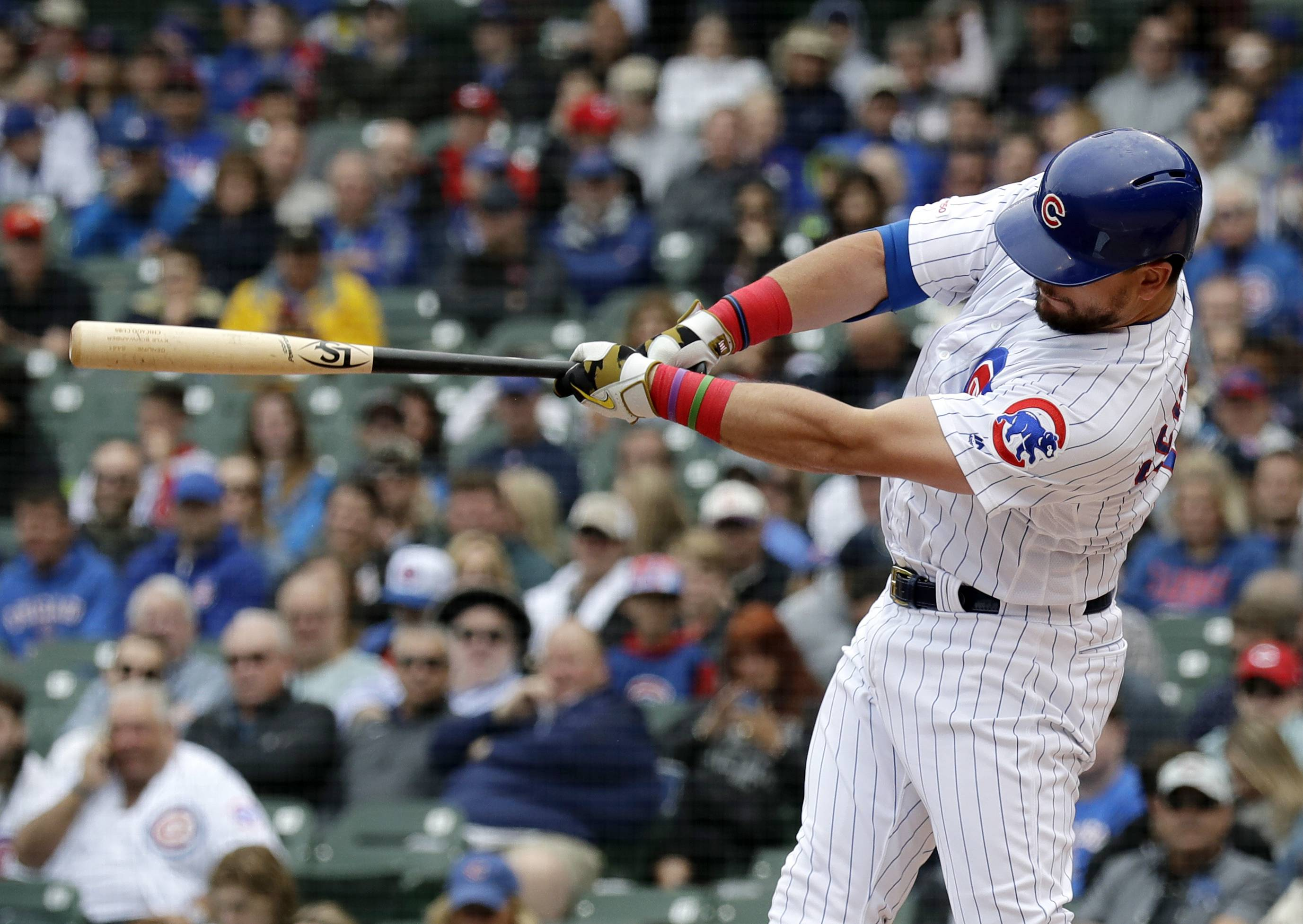 Chicago Cubs' Kyle Schwarber hits a solo home run during the first inning Friday against the Reds at Wrigley Field. It was Schwarber's eighth homer of the season and his first career leadoff homer.