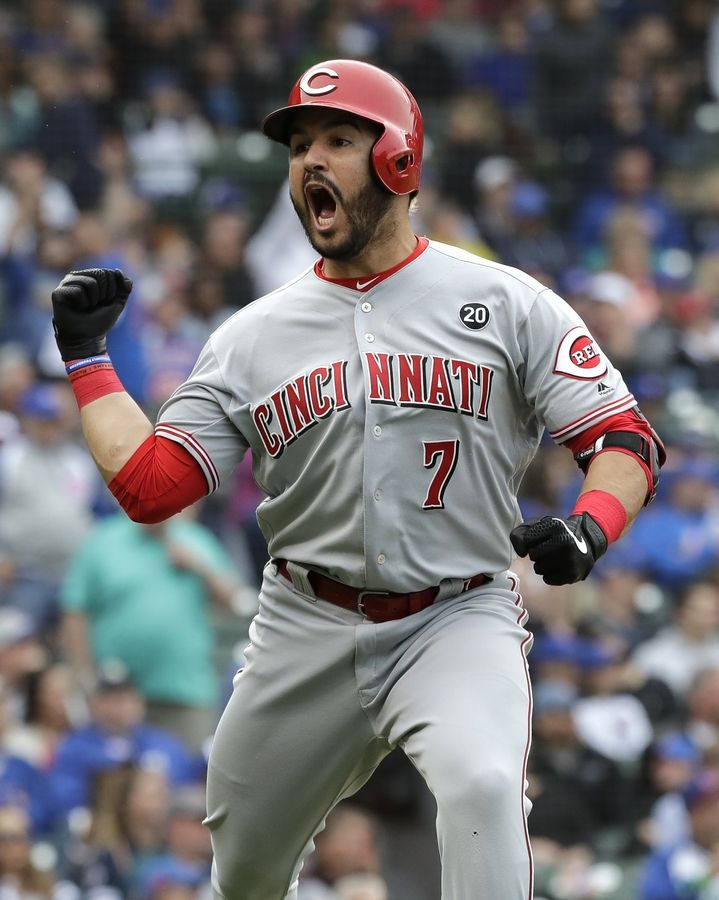 Cincinnati Reds' Eugenio Suarez celebrates as he rounds the bases after hitting a two-run home run during the ninth inning of a baseball game against the Chicago Cubs, Friday, May 24, 2019, in Chicago.