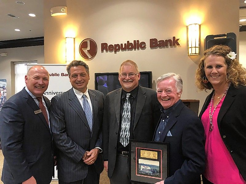 From left, Tom Bugielski, President & CEO Republic Bank; Aristotle Halikias, chairman of the board of Republic Bank; Steve Macek, Woodstock & Pop Culture Historian and Professor at North Central College; Mark Rice, attendee at the original Woodstock; and Amanda Sloan, AVP, branch sales manager of Republic Bank, attend the bank's recent reception featuring a collection of iconic photographs commemorating the 50th Anniversary of the Woodstock music festival.