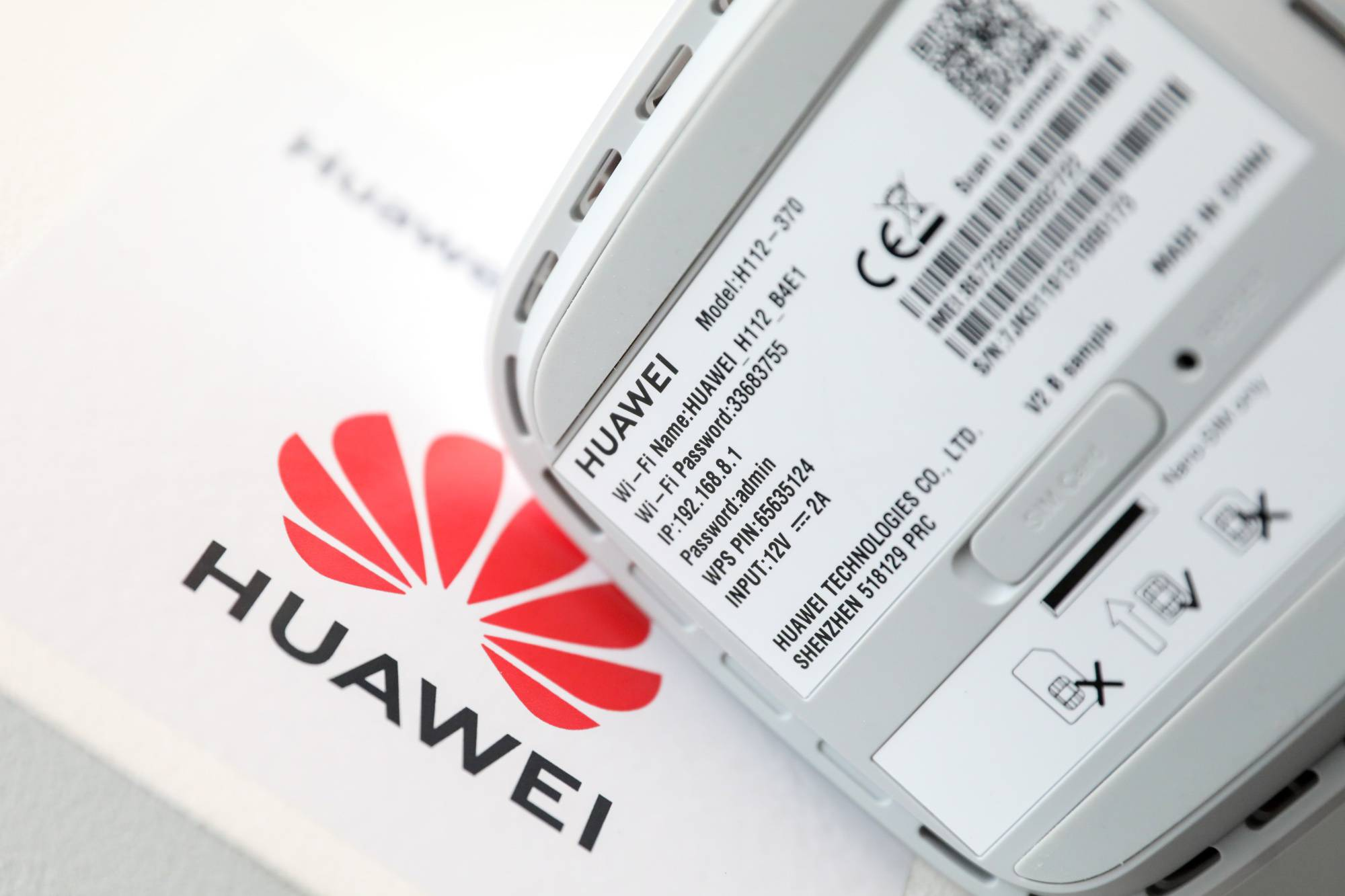 Information sits on the base of a 5G CPE (customer-premises equipment) Pro router, manufactured by Huawei Technologies in London.