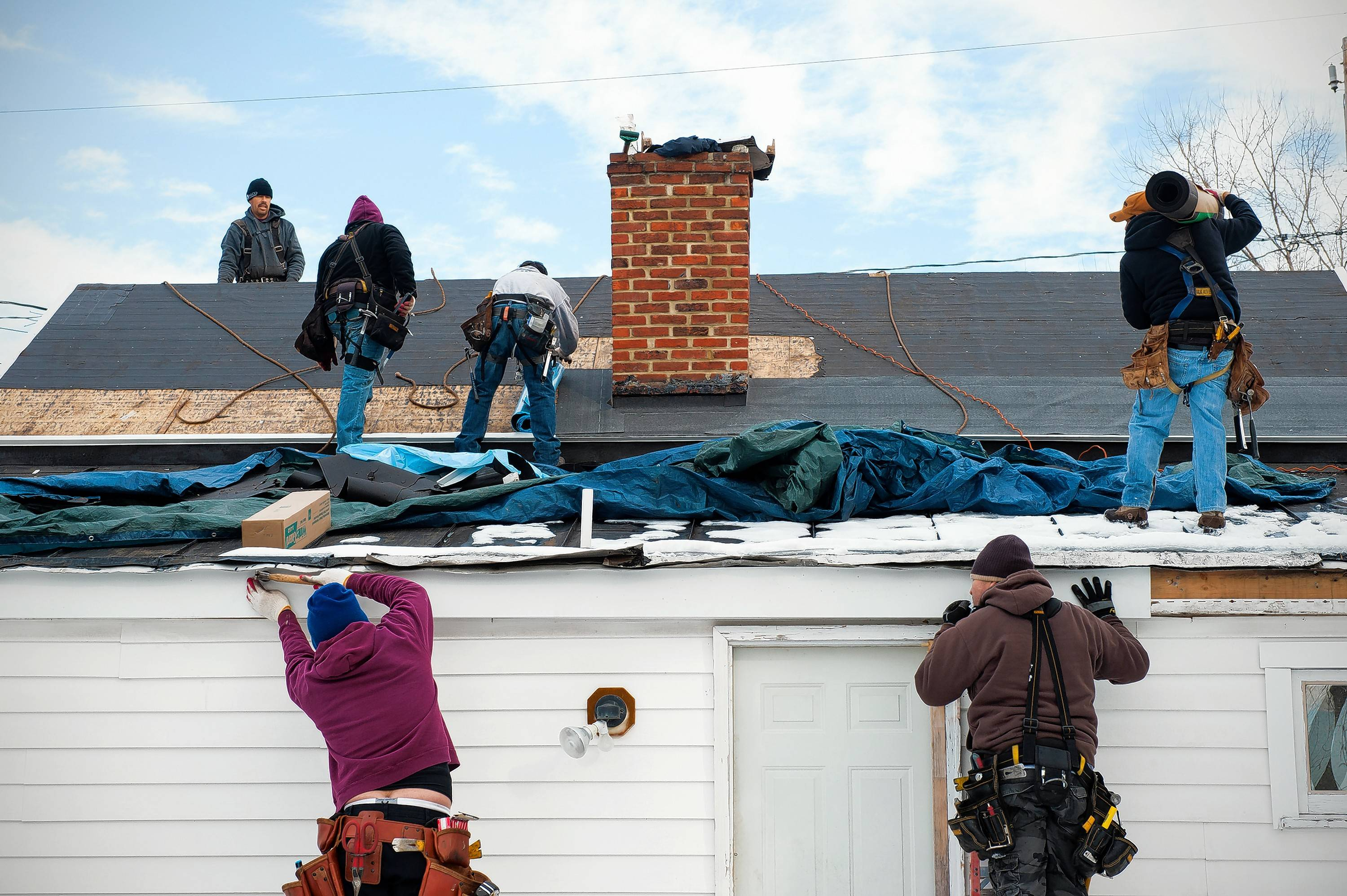 Workers replace a roof in Leesburg, Virginia.