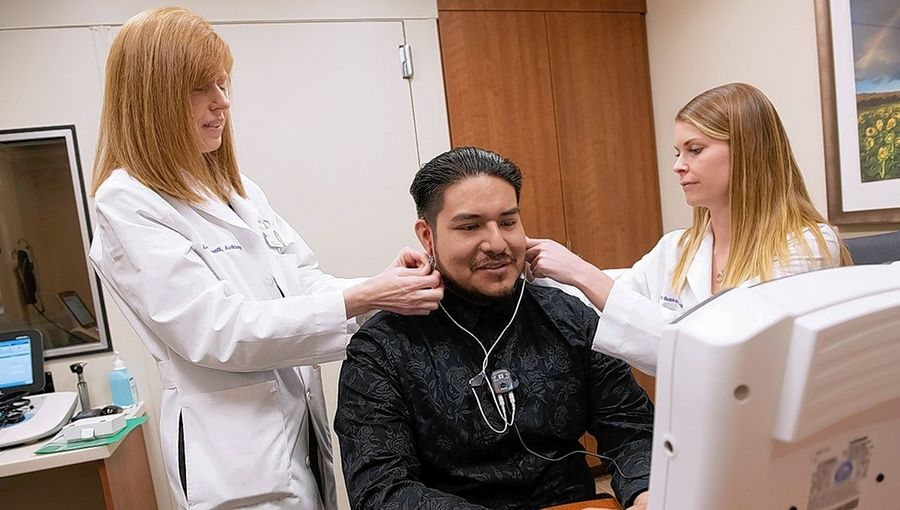 Fernando Hernandez undergoes a hearing test provided by audiologists Laura Spinelli and Laura Buskirk at the Northwestern Medicine Regional Medical Group Hearing Aid Dispensary at Central DuPage Hospital