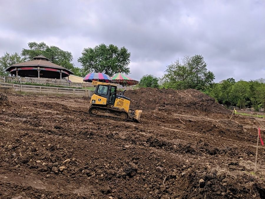 A worker moves dirt on the future site of Santa Springs, a water park coming to Santa's Village in East Dundee. The park celebrated the 60th anniversary of its opening with a ceremony Saturday afternoon.