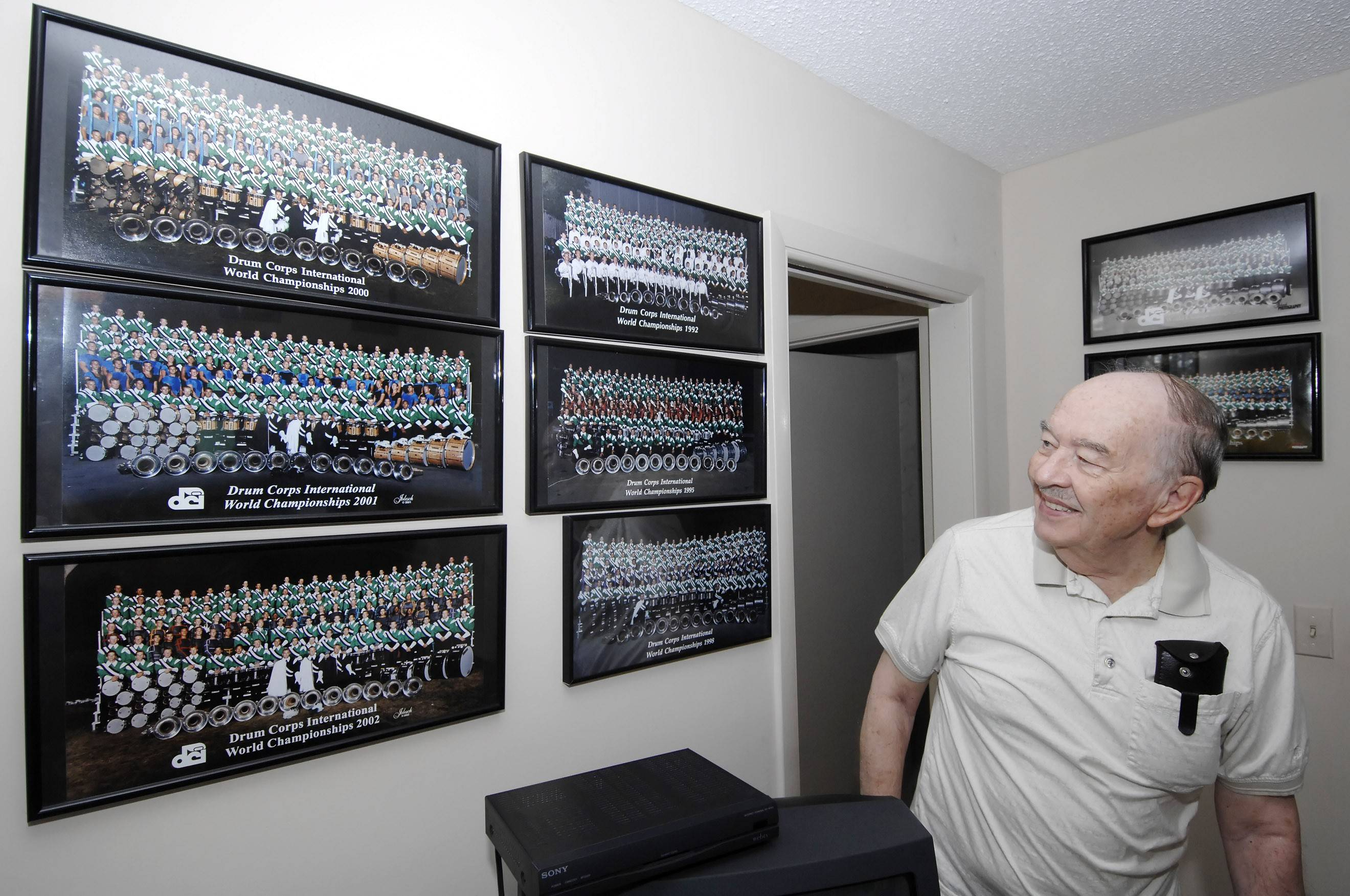 Don Warren, in his Wood Dale home, displays memorabilia from his 60-year association with the Rosemont Cavaliers in 2008 as he steps back to take a less active role in the drum and bugle corps that he founded.