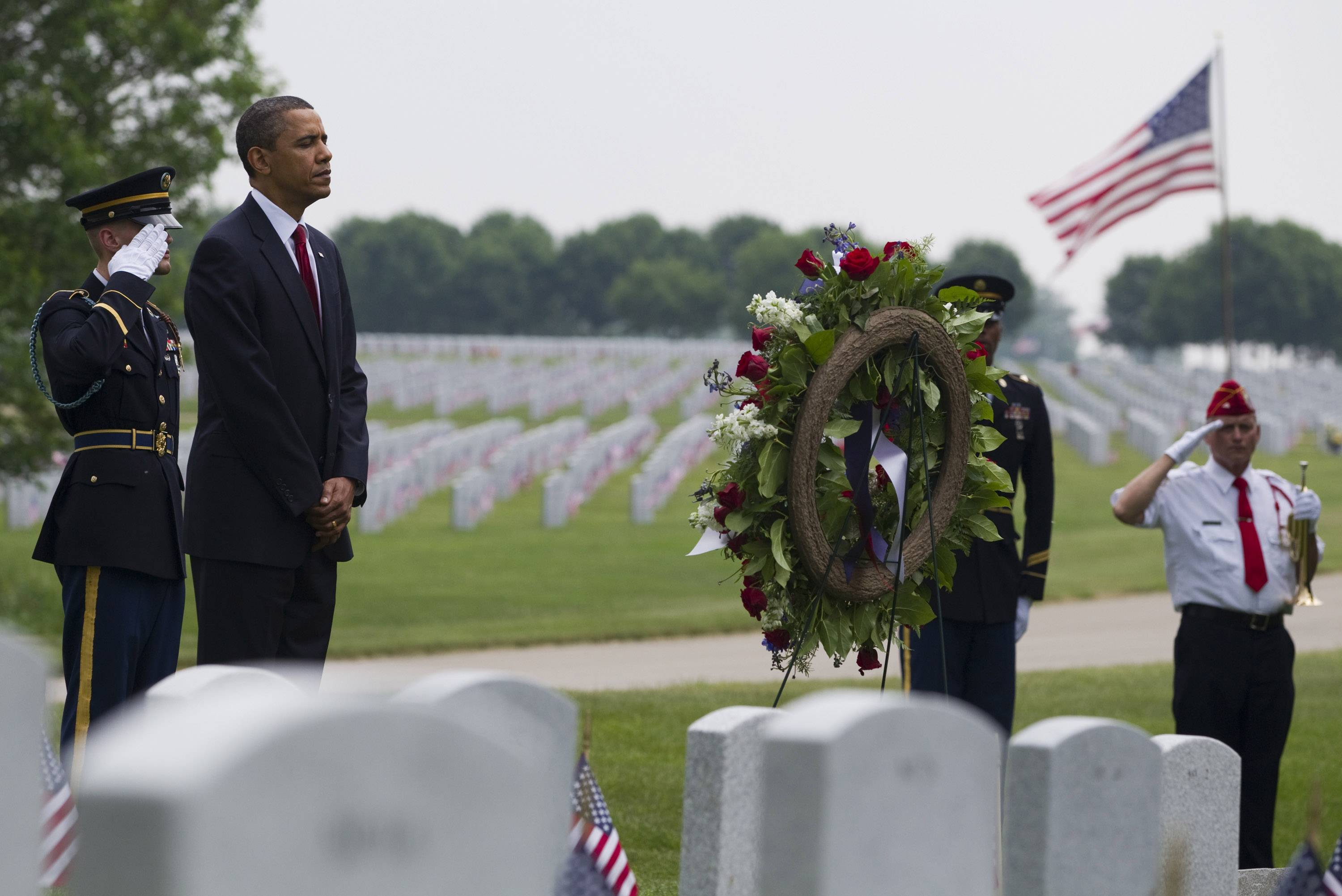 President Barack Obama lays a wreath and stands for a moment of silence before a Memorial Day ceremony at Abraham Lincoln National Cemetery on May 31, 2010, in Elwood, Ill. False rumors that he spent the day at a friend's barbecue have been circulating online.