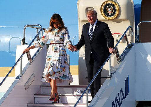 U.S. President Donald Trump and first lady Melania Trump arrive at the Haneda International Airport Saturday, May 25, 2019, in Tokyo.