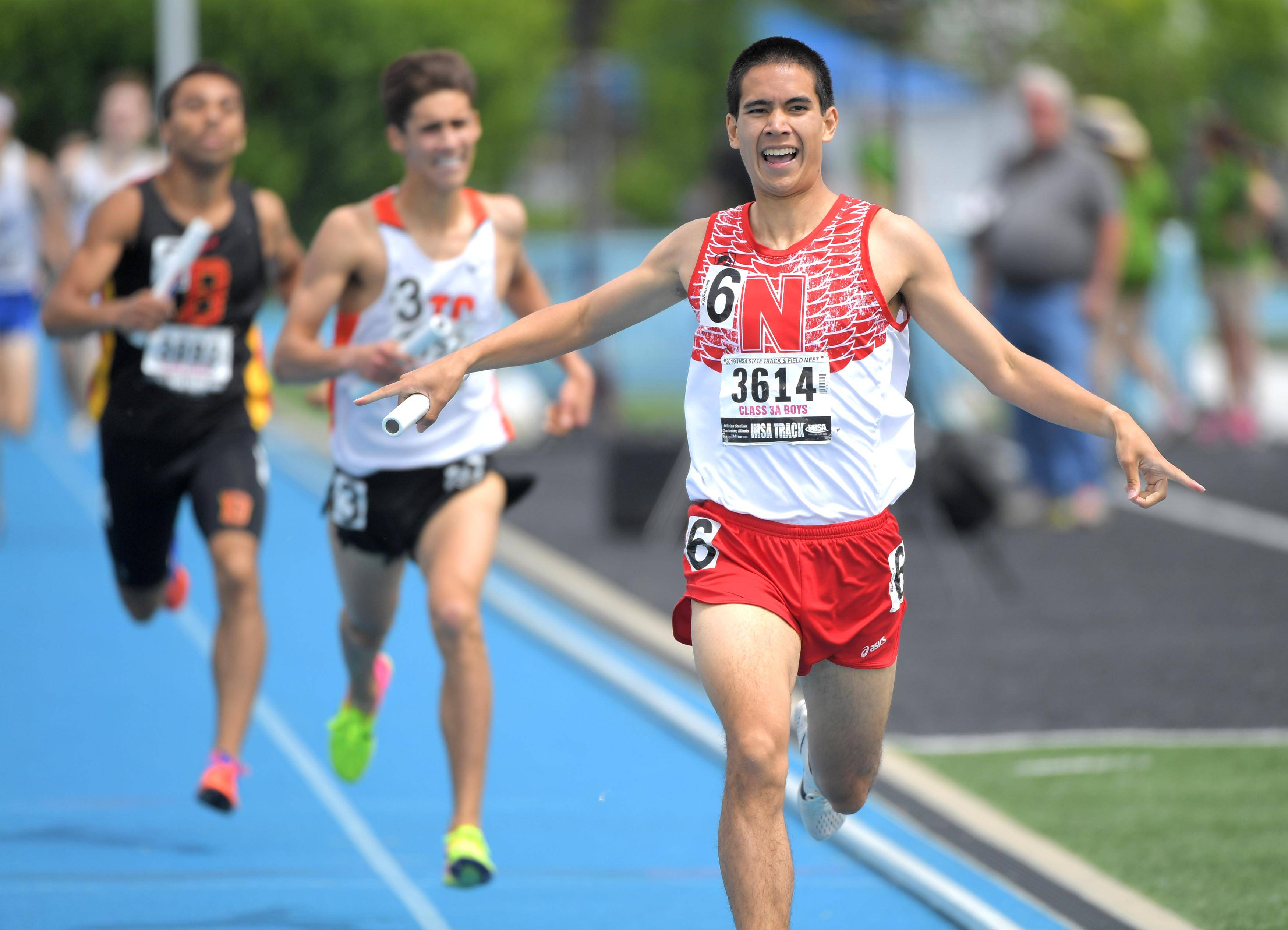 Naperville Central's Thomas Shilgalis finishes his anchor leg in first place in the Class 3A 3,200-meter relay at the IHSA boys state track finals in Charleston Saturday.