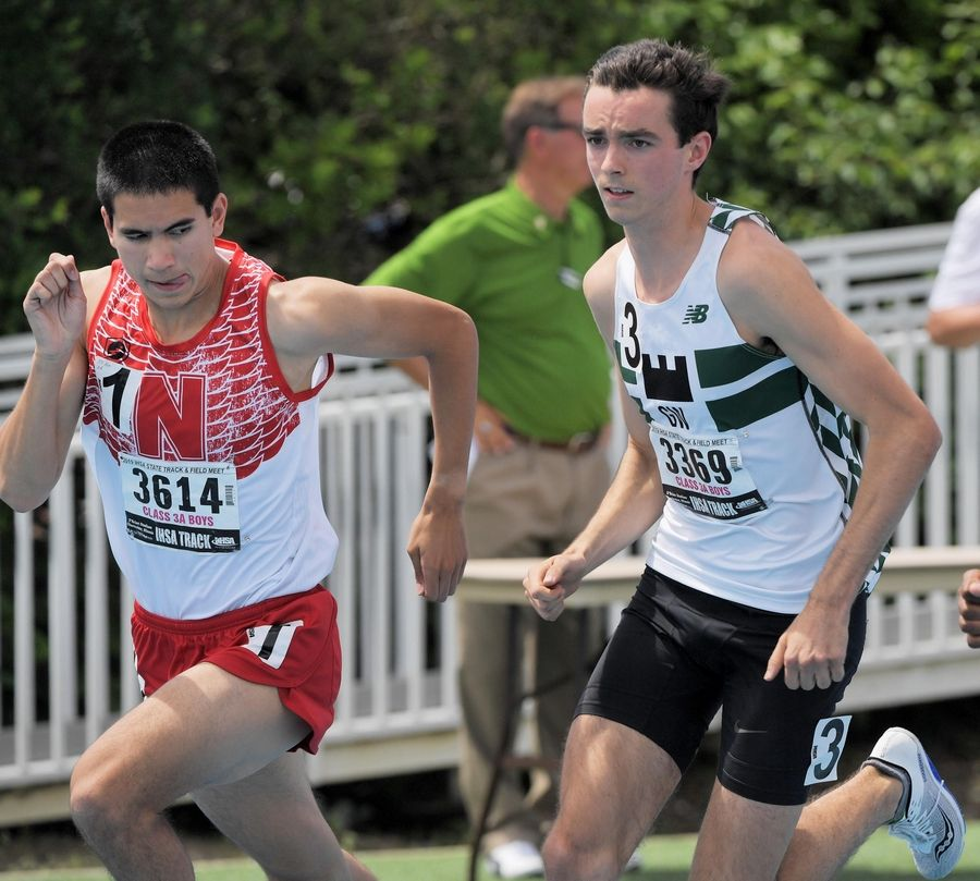 John Starks/jstarks@dailyherald.comNaperville Central's Thomas Shilgalis looks over his shoulder at Glenbard West's Will Obrien at the start of the Class 3A 800-meter run at the IHSA boys state track finals in Charleston Saturday.