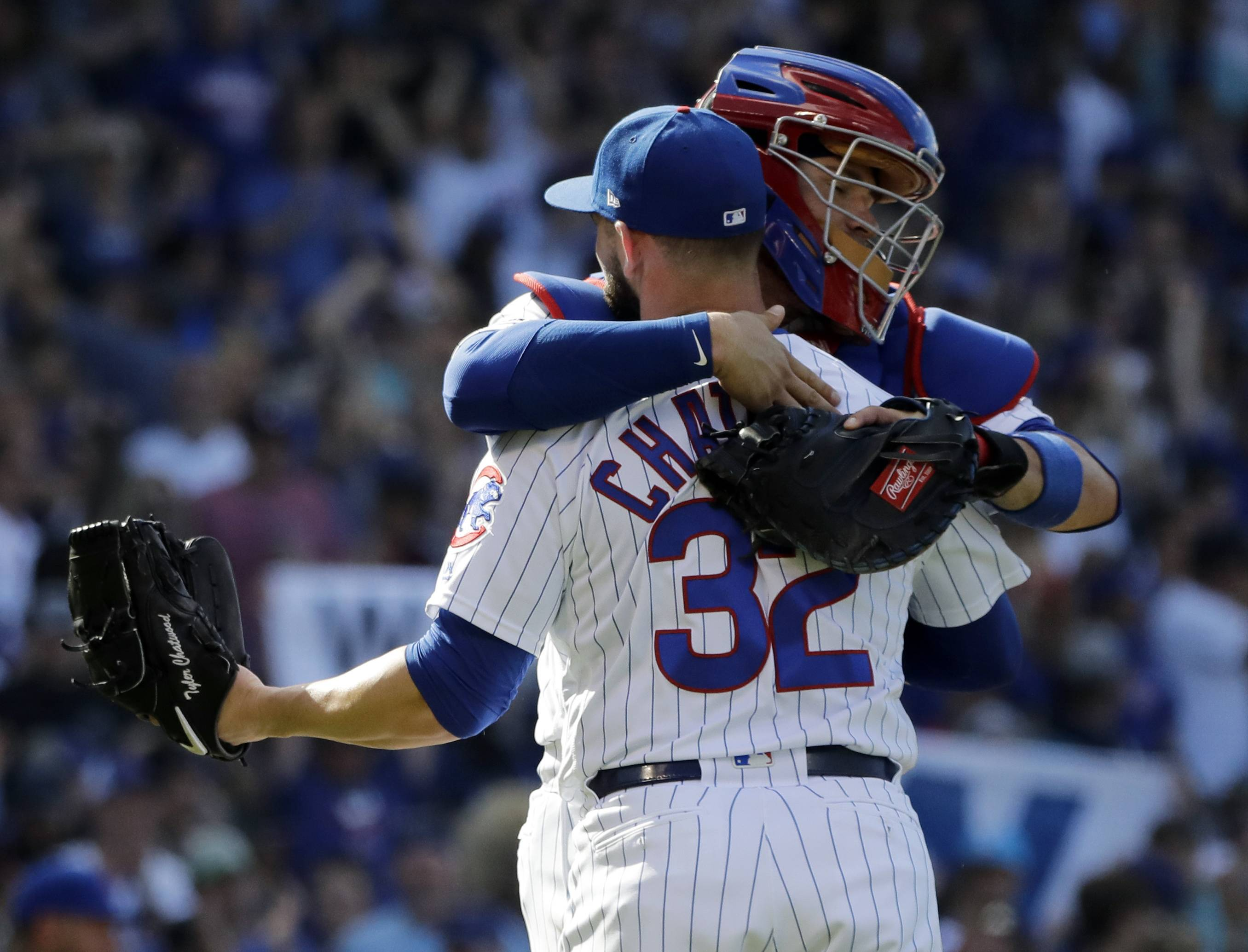 Chicago Cubs relief pitcher Tyler Chatwood (32) celebrates with catcher Victor Caratini after the Cubs defeated the Cincinnati Reds 8-6 in a baseball game, Saturday, May 25, 2019, in Chicago. (AP Photo/Nam Y. Huh)