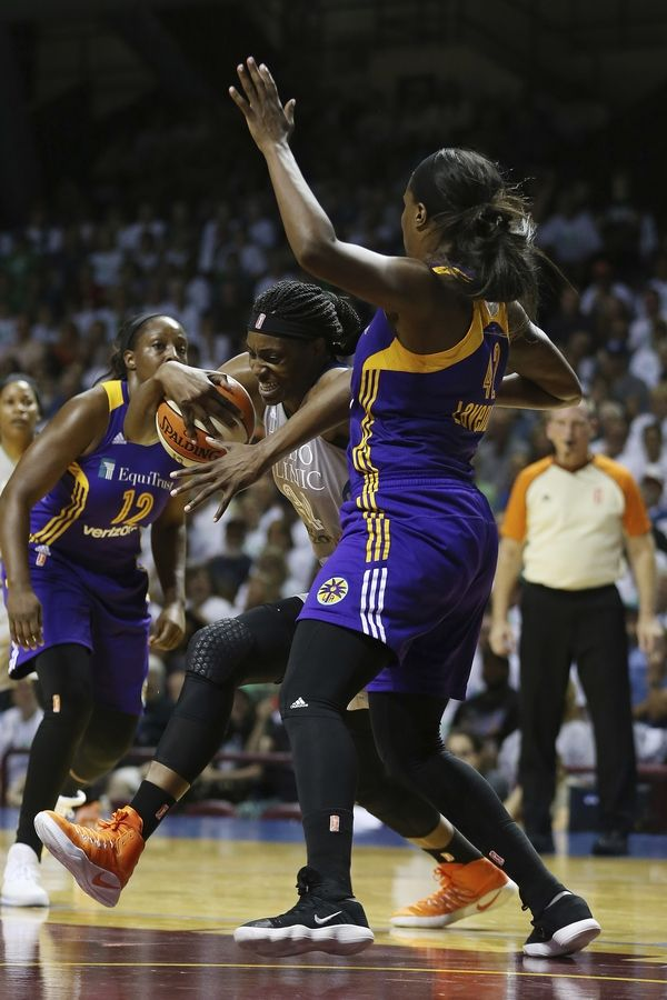 Minnesota Lynx center Sylvia Fowles (34) tries to push the ball through the defense of Los Angeles Sparks center Jantel Lavender (42) in the first half of Game 1 in the WNBA basketball finals game, Sunday, Sept. 24, 2017, in Minneapolis.