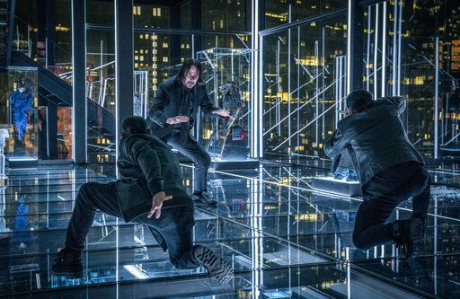 "This image released by Lionsgate shows Keanu Reeves in a scene from the film, ""John Wick: Chapter 3 - Parabellum."" (Niko Tavernise/Lionsgate via AP)"