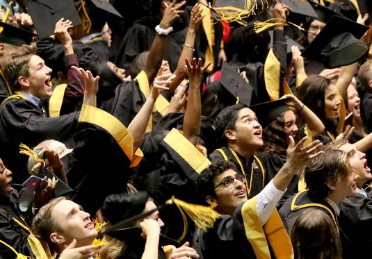 Members of the Class of 2019 toss their caps to conclude Metea Valley High School graduation on Sunday, May 26, 2019 at the Convocation Center on the campus of Northern Illinois University.