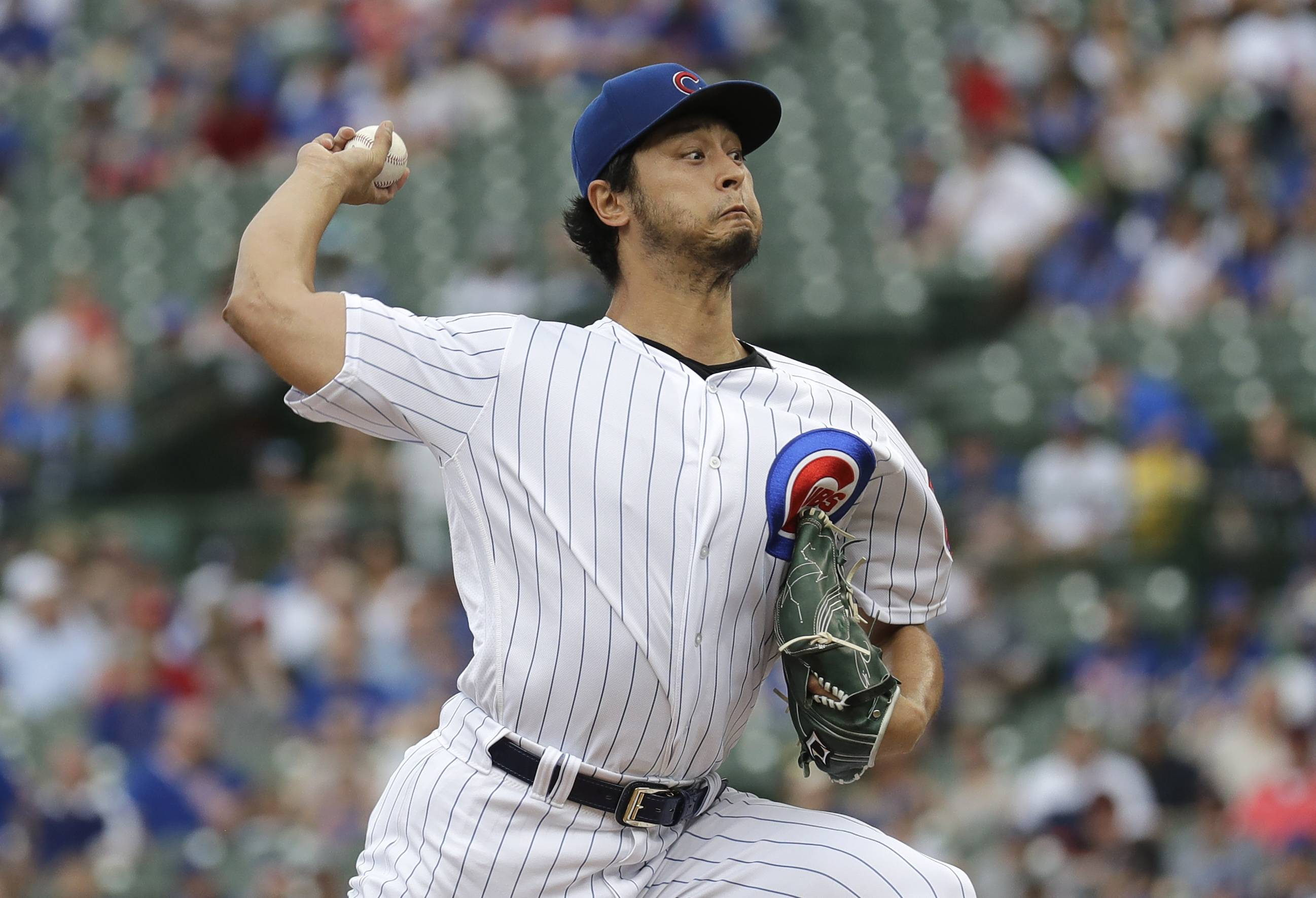 Chicago Cubs starting pitcher Yu Darvish throws against the Cincinnati Reds during the first inning of the game Saturday at Wrigley Field. Manager Joe Maddon said he believed the longer outing will benefit Darvish down the line.