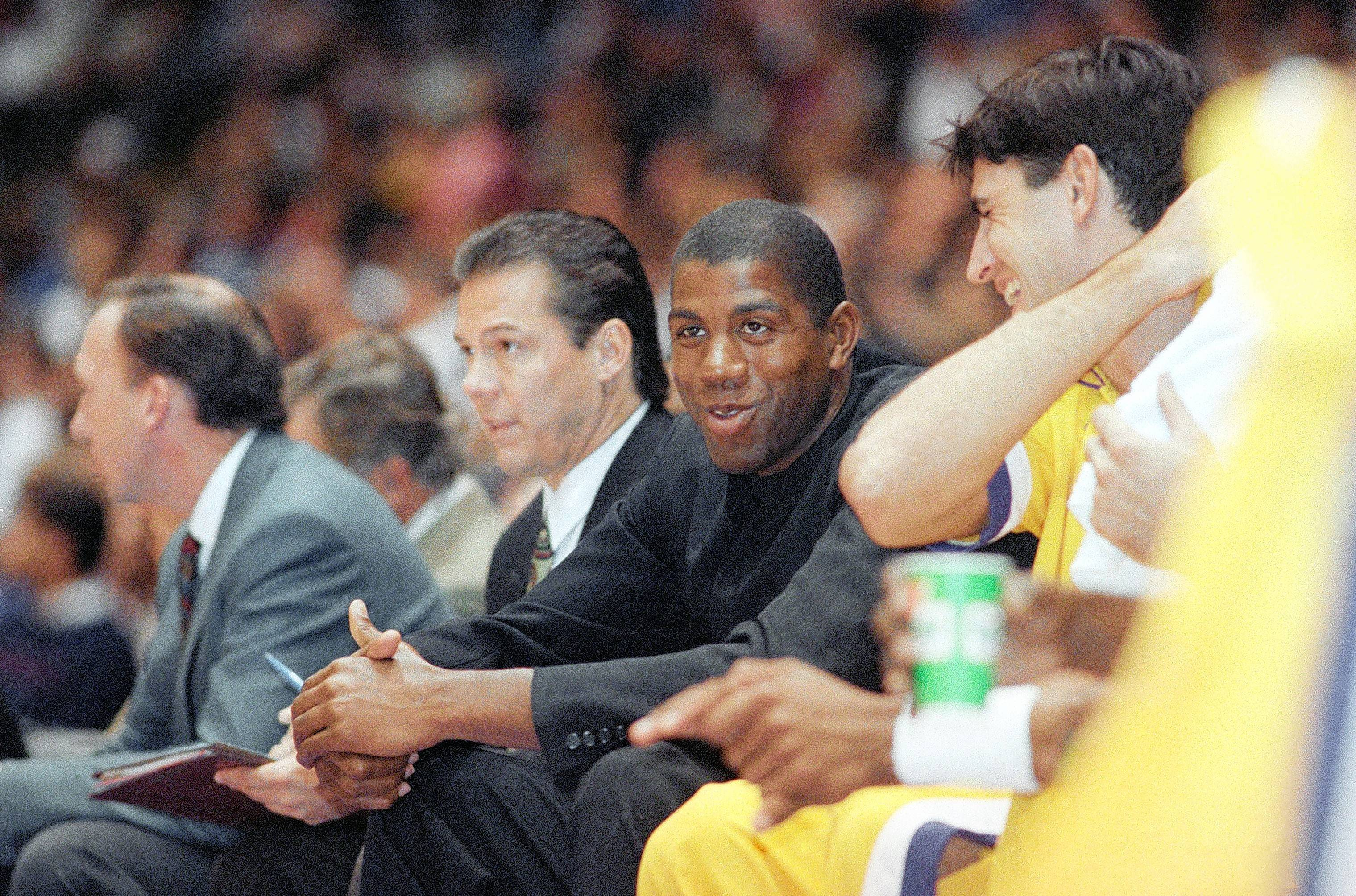 Former Los Angeles Lakers assistant coach Randy Pfund, left center, shared his thoughts on Magic Johnson's, right center, exit from the Lakers and what it takes to run a sound organization.