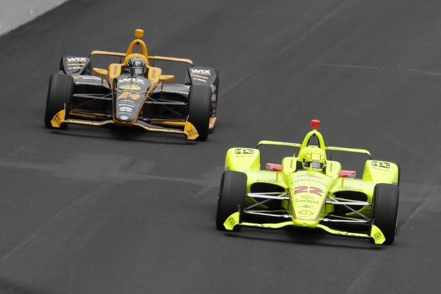 Simon Pagenaud, of France, leads Sage Karam into the first turn during the Indianapolis 500 IndyCar auto race at Indianapolis Motor Speedway, Sunday, May 26, 2019, in Indianapolis.
