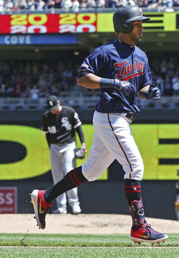 Minnesota Twins' Eddie Rosario jogs home on a three-run home run off Chicago White Sox pitcher Dylan Covey, back left, in the third inning of a baseball game Sunday, May 26, 2019, in Minneapolis.