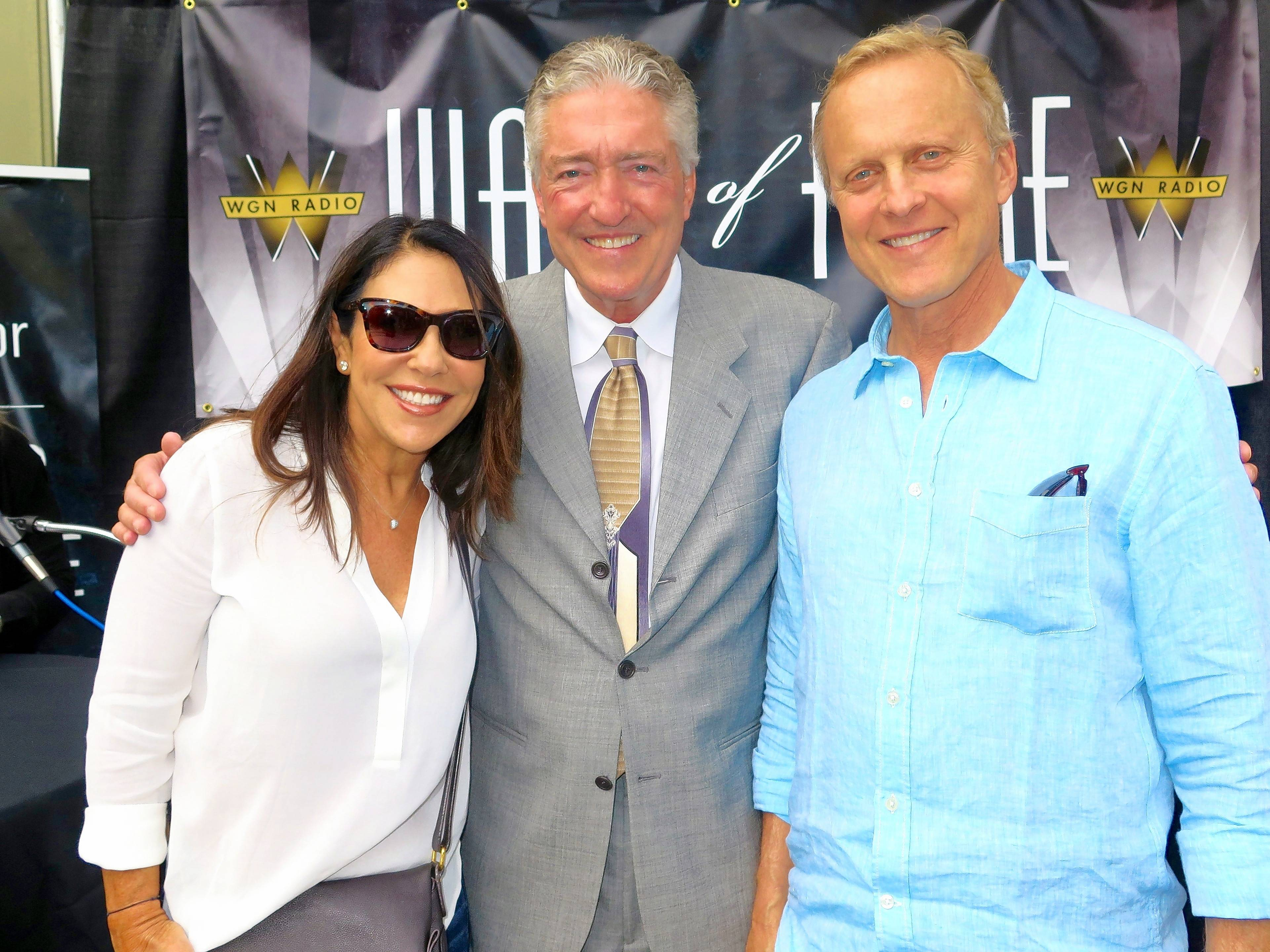 Cubs radio broadcaster Pat Hughes celebrates his WGN Radio Walk of Fame induction in 2014 with Bob Sirott and wife Marianne Murciano.